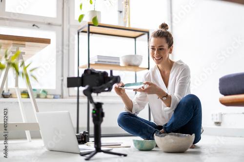 Female vlogger making social media video about her pottery Fototapeta