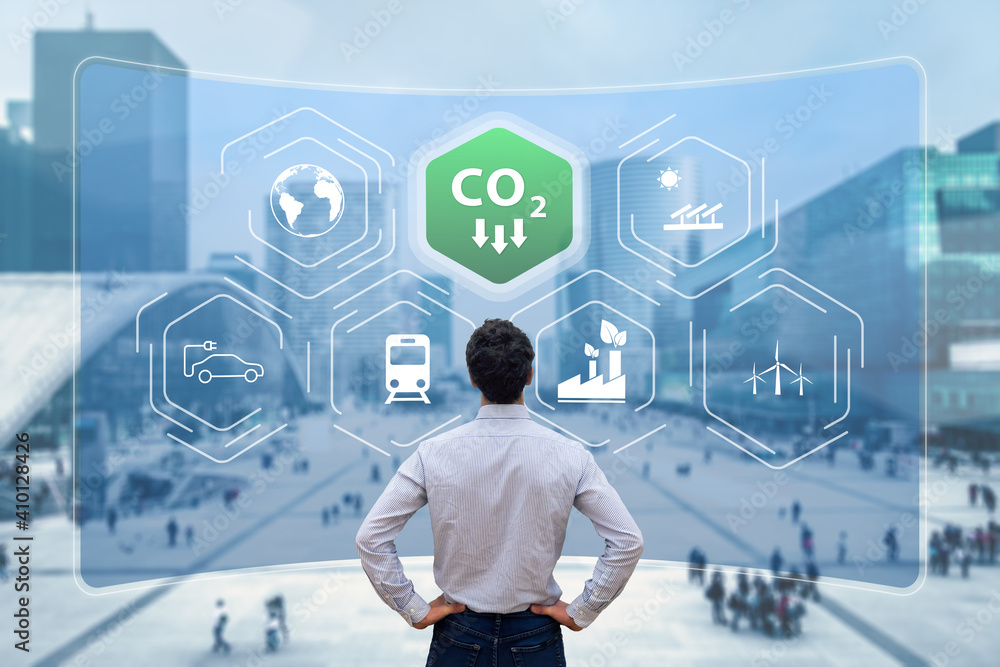 Fototapeta Reduce Carbon Dioxide Emissions to Limit Global Warming and Climate Change. Commitment to Paris Agreement to Lower CO2 levels with Sustainable Development as Renewable Energy and Electric Vehicles
