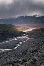 Glacier Water Runs Into A Valley; Kyrgyzstan