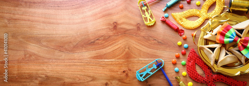 Fototapeta Purim celebration concept (jewish carnival holiday) over wooden background. Top view, flat lay obraz
