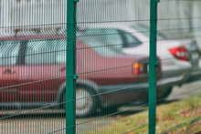 Fenced Car Parking Lot With Security