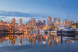 Evening cityscape view of Granville Island and Vancouver downtown waterfront skyline from Island Park Walk.