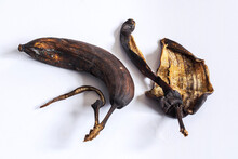 Dried Up Rotten Decomposed Banana And Peel On White Table - Concept And Idea Background
