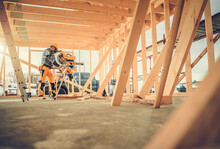 Carpenter Contractor Worker Using Circular Saw In Construction Zone