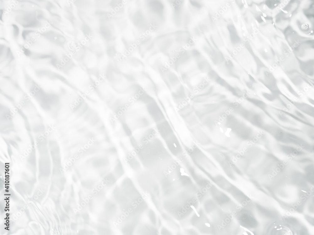 Fototapeta Ripple water texture on white background. Shadow of water on sunlight. Mockup for product, spa or travel background. Marble blue water surface as wallpaper background