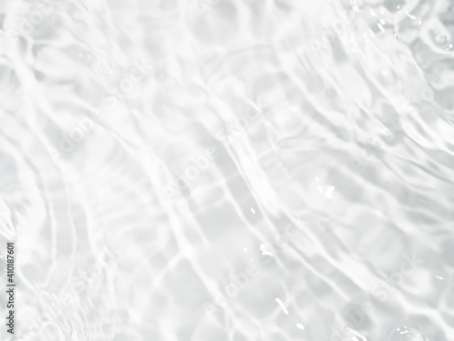 Ripple water texture on white background. Shadow of water on sunlight. Mockup for product, spa or travel background. Marble blue water surface as wallpaper background