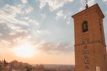 Golden Light Of A Setting Sun Over Terracotta Rooftops In Toledo, Spain