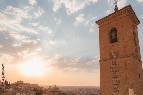 Fototapeta Golden light of a setting sun over terracotta rooftops in Toledo, Spain