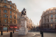 A View Of The Equestrian Statue Of Charles I From Trafalgar Square In Central London City, England UK As Golden Light Crests The Building Tops.