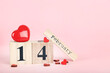 February block calendar with red hearts on pink background