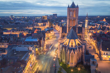 The Beautiful Historic Old Town Of Ghent, Belgium At Night After Sunset During Blue Hour And The Saint Nicholas' Church.