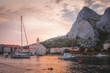 Sunset View Of Omis, Croatia In Split-Dalmatia County Featuring A Large Rock Face Popular With Rock Climbers.