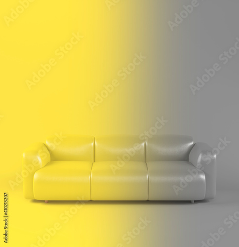 Leather soft sofa on yellow gray background with shadow. Color of year 2021. Illuminating and Ultimate gray. Stylish cozy modern sofa made of genuine leather on wooden legs. Single piece of furniture © olgaarkhipenko