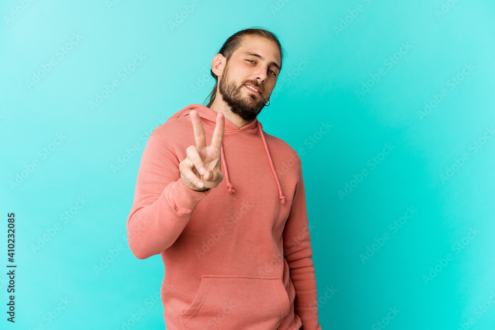 Fototapeta Young man with long hair look showing number two with fingers.