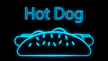 Hot Dog On A Black Background, Neon, Illustration. Sausage Sandwich, Stuffed, Appetizing Bun. Neon With The Inscription Hot Dog In Blue. Bright Signboard For Cafe, Restaurant