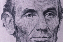 President Abraham Lincoln On The Obverse Of A Five Dollar Bill For Background.