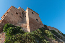 Low Angle Shot Of An Old Medieval Brick Castle Under The Clear Sky