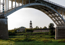 Arch Bridge Over The Volga River In Staritsa, Russia.On The Background Of The Bell Tower.