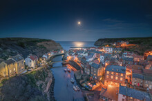 Moonrise Over The North Yorkshire Fishing Village Of Staithes.
