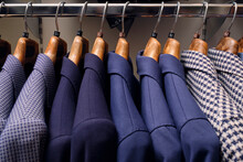 Row Of Blazers On Rack In Tailors Boutique