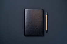Black Leather Notebook On A Paper Black Background, Notepad Mock Up, Top View Shot