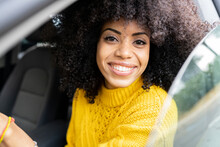 Happy Woman Smiling While Driving Car