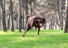 Two Professional Dancers Performing In Underwear In Middle Of Forest