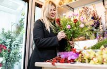 Florist Making Bouquet At Flower Shop