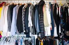 Variation Of Clothes Hanging On Rack In Wardrobe At Apartment