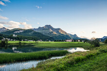 Switzerland, Canton Of Grisons, Sils Im Engadin, Shore Of Lake Sils With Mountain Village In Background