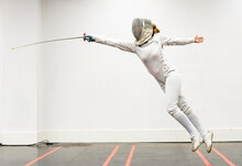 Womanin Fencing Outfit Practicing At Gym
