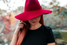 Close-up Of Mid Adult Woman Wearing Red Hat In Park