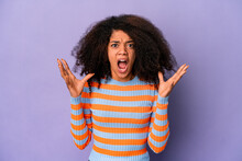 Young African American Curly Woman Isolated On Purple Background Screaming To The Sky, Looking Up, Frustrated.