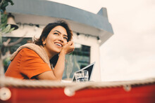 Smiling Female Entrepreneur With Hand On Chin Looking Away By Laptop In Houseboat