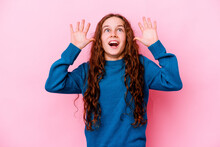 Little Caucasian Girl Isolated On Pink Background Screaming To The Sky, Looking Up, Frustrated.