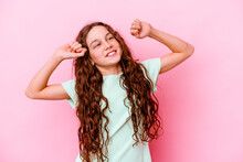 Little Caucasian Girl Isolated On Pink Background Celebrating A Special Day, Jumps And Raise Arms With Energy.