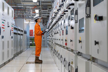 Electrician Check And Recording High Voltage Electrical Switch Board Parameter At Switch Gear Room For Monitor Power Generation Reliability Of Offshore Oil And Gas Processing Platform.