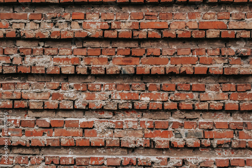 Photo The texture of an old brick wall with natural defects