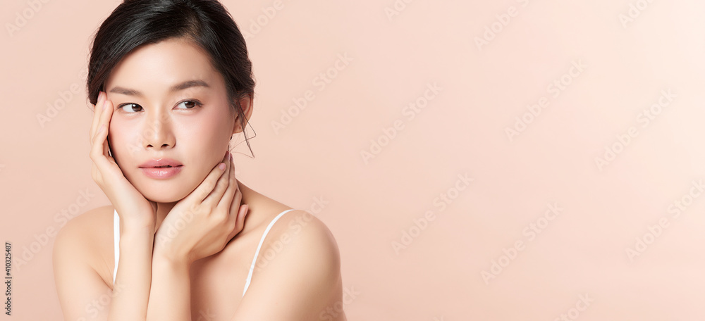 Fototapeta Beautiful young asian woman with clean fresh skin on beige background, Face care, Facial treatment, Cosmetology, beauty and spa, Asian women portrait