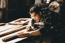 Carpenter Man Attend To Making Masterpiece Woodworks Handcrafted Furniture Fine Measure In Wood Workshop.