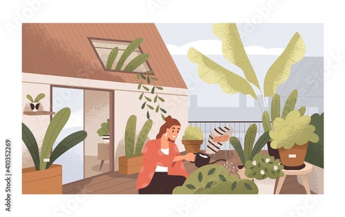Woman watering plants at home balcony garden with greenery Fototapet