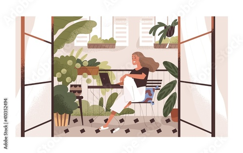 Obraz na plátně Woman working or relaxing with laptop at home balcony garden with furniture and potted plants