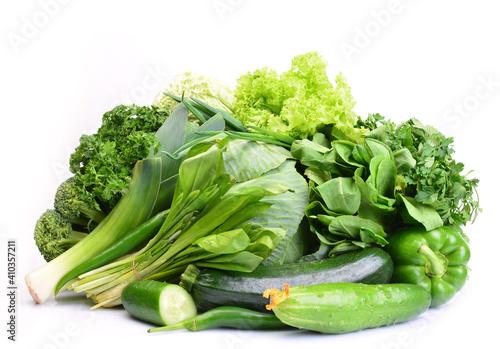 Canvas Fresh green vegetables on white background