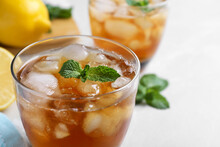 Delicious Iced Tea In Glass On Light Table, Closeup. Space For Text