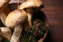 Fresh Wild Porcini Mushrooms In Bowl On Wooden Table, Closeup