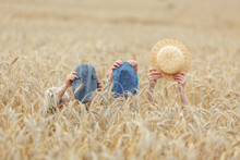 Mom And Her Sons Hid In The Wheat. They Hold Only The Caps In Their Hands.