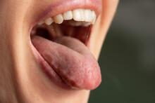 Open Mouth Tongue Lips Of A Young Girl Close-up