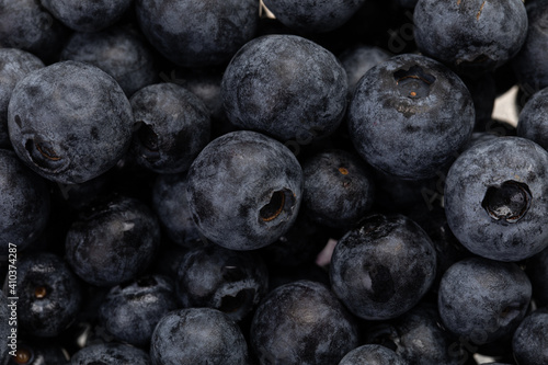 Valokuvatapetti background with fresh blueberries in close up