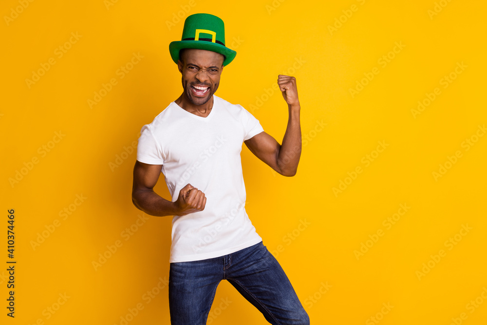 Fototapeta Portrait of his he nice attractive ecstatic cheerful cheery guy wearing festal hat celebrating attainment isolated over bright vivid shine vibrant yellow color background