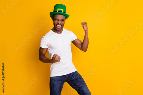 Obraz Portrait of his he nice attractive ecstatic cheerful cheery guy wearing festal hat celebrating attainment isolated over bright vivid shine vibrant yellow color background - fototapety do salonu